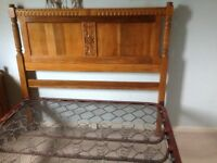 Oak and metal framed double bed