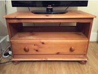 Small wooden sideboard, also used as TV stand.