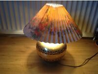 Brass lamp with lamp shade. Very cosy.