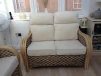 Cane Sofas with Cream Cushions