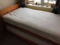 M&S pine single bed on castors with pull out bed underneath inc mattresses