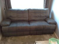 Modern grey recliner sofa for sale. Two years old.