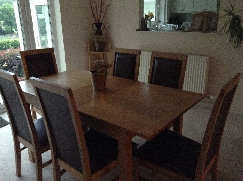 Light oak dining table and 6 faux leather chairs and matching sideboardin Caldicot, MonmouthshireGumtree - Extending light oak dining room table extended 150 X 80 cm, 6 brown faux leather chairs with stitching details. Matching sideboard 125 X 40 cm with 3 drawers and 3 cupboards Good condition