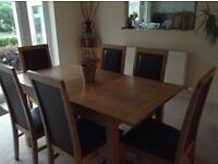 Light oak dining table and 6 faux leather chairs and matching sideboard