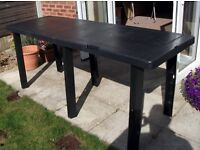 Outdoor folding table,colour black, internal storage for the legs.