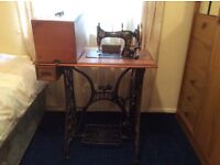 Vintage Ppaff treadle sewing machine. Original stand and lid with tools.