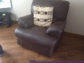 Brown Leather two seat Sofa and electric recliner chair to match