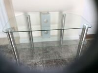 Glass and metal tv table. 3 shelves. L 80cm. H48cm W45cm. Good condition