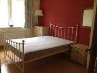Cream iron wrought double bed for sale. Good condition.
