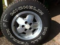 """15"""" Jeep rim and tire for sale"""