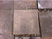 "11 used square paving slabs, 24"" (610mm) x 2"" (50mm) thick."