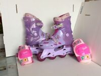Rollerblades and knee & elbow protectors. Adjustable - to fit size 2 to 4