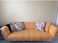 3-4 seat sofa,warm yellow with four contrasting cushions
