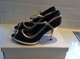 Beautiful Party Shoes, Black and Gold Court Shoe with Strap Fitting