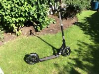 Black M-CRO adult scooter. 2 yrs old, hardly used, excellent condition. Cost £170 new.