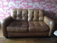 Two seater leather sofa and storage stool