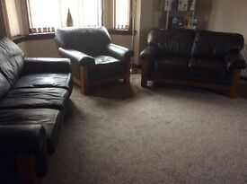 Brown Leather 3 piece suite for sale 3,2,1, with Oak wood . £150