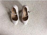 Ladies cream shoes.