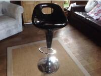 2 black retro height adjustable stools