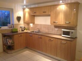 Symphony Gloss Kitchen units - very good condition - available in approximately 4 weeks