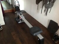 Purefitness & sports foldable magnetic rowing machine with hand pulse.