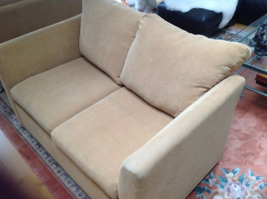 A. gold coloured sofa three seater. Professionally cleaned.