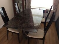 Marble dining room table and four upholstered chairs. Immaculate.