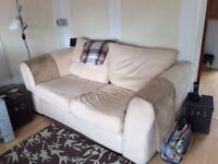 2 seater sofa and chair in beige faux suede.