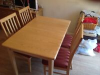"""Extending wooden table and upholstered chairs, all in excellent condition. Size 48""""x32""""x30"""" high."""