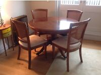 Cherry wood round (extendable) dining table and 4 chairs