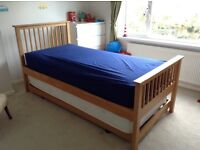 Single bed frame with pull out guest bed