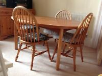 Extending dining table (seats 8) and 4 chairs