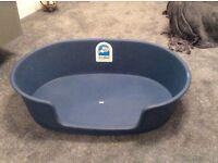 Dog basket, dark blue plastic and hardly used. Size 90cm x 50 cm.