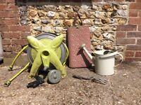 Garden hose on reel and gardening equipment