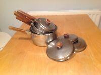Set of copper bottom saucepans