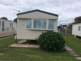 6 BERTH CARAVAN SITED AT HOBURNE NAISH, NEW MILTON, HANTS / DORSET BORDER
