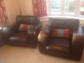 Two John Lewis leather armchairs with cushions