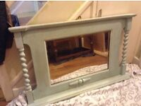 Lovely mirror with wooden surround. Hang above the fireplace. Painted pale green