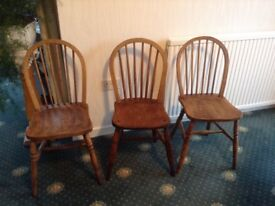 Three lovely solid wood chairs.
