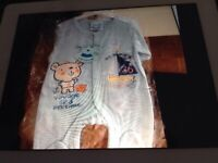 Brand New Rock A Bye Baby ,box of baby grows on hangers with labels