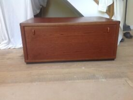 TV stand/storage unit with pull out and drop down drawer. Mahogany