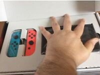 Nintendo Switch (coloured version) With Zelda breath of the Wild.