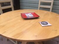 ' Next ' dining table