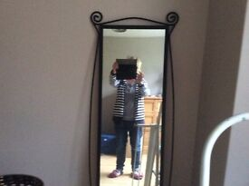 4 1/2 foot long lovely black iron mirror, in good condition