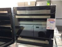 Single electric oven and seperate warming drawer new graded 12 months gtee