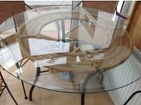 Glass round rattan effect table and 4 chairs - dining room or conservatory