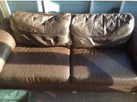 Two Brown leather sofas, old but comfy.