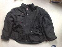 XL Motor cycle jacket make is gear. It has Cordova hi - kevlar