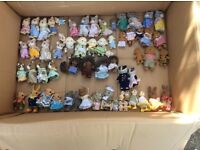 Four boxes of Sylvanian families, houses and furniture