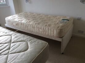 Bed with guest bed stored under